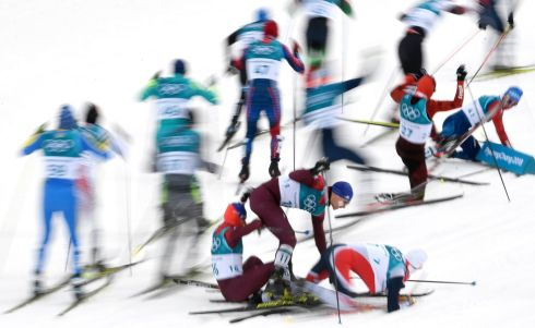 Athletes crash after the start of the Men's ross Country Skiathlon race at the Alpensia Cross Country Centre during the PyeongChang 2018 Olympic Games. Photograph: Filip Singer/EPA