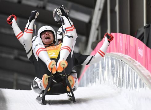 Austrian athletes celebrate after competing in the team relay competition luge final. Photograph: Mark Ralston/AFP/Getty Images