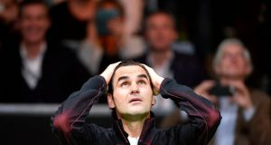 Roger Federer celebrates his victory over Robin Haase in their quarter-final singles tennis match in Rotterdam. Photograph: Getty Images