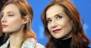 Isabelle Huppert (right) during a photocall for Eva at the 68th annual Berlin International Film Festival. Photograph: EPA