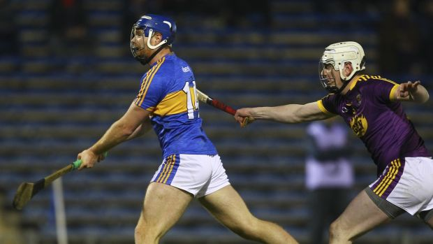 Tipperary's Jason Forde scores a goal while under pressure from Wexford's Liam Ryan during the Allianz Hurling League Division 1A match at Semple Stadium in Thurles. Photograph: Ken Sutton/Inpho
