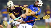 Tipperary's Patrick Maher is tackled by Wexford's Liam Ryan during the Allianz Hurling League Division 1A match at  Semple Stadium in Thurles. Photograph: Ken Sutton/Inpho