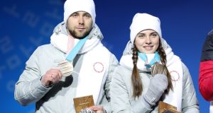 Aleksandr Krushelnitckii and his wife Anastasia Bryzgalova show off their bronze medals from the mixed doubles curling. Krushelnitckii is suspected of having tested positive for meldonium. Photograph: Andreas Rentz/Getty Images