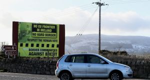 A sign, erected by Border Communities Against Brexit, outside Newry, Co Down. Photograph: Brian Lawless/PA Wire
