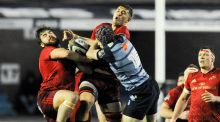 Munster's Rhys Marshall and Gerbrandt Grobler fight for possession with  Cardiff Blues' Rhun Williams at Cardiff Arms Park. Photograph: Kevin Barnes/Inpho