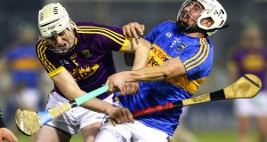 Tipperary's Patrick Maher feels the weight of Liam Ryan's tackle at Semple Stadium. Photograph: Ken Sutton/Inpho