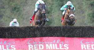 Our Duke and Robbie Power (left) win the Grade Two  Red Mills Steeplechase from Presenting Percy  at Gowran Park. Photograph: PA Wire