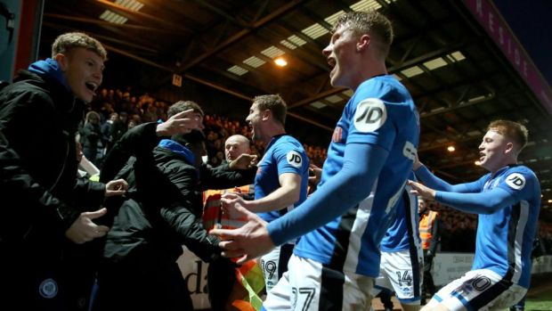 Rochdale's Steve Davies celebrates with team-mates and fans after scoring his side's late equaliser. Photograph: Tim Goode/PA Wire