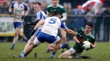 Kerry's Brian O'Beaglaoich is tackled by  Neil McAdam of Monaghan. Photograph: Tommy Dickson/Inpho
