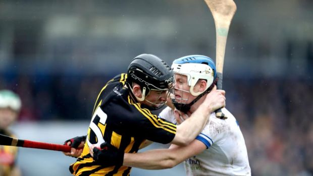 Conor Delaney of Kilkenny and Waterford's Tom Devine battle it out during the Allianz Hurling League Division 1A game at Walsh Park. Photograph: Bryan Keane/Inpho