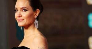 Angelina Jolie arrives at the Bafta awards at the Royal Albert Hall, London on Sunday. Photograph: Hannah McKay/Reuters