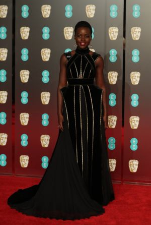 Actor Lupita Nyong'o poses on the red carpet.  Photograph: Daniel Leal-Olivas/AFP/Getty Images