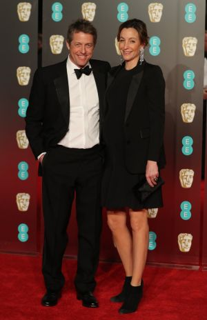 Actor Hugh Grant and producer Anna Eberstein pose on the red carpet at the Bafta awards. Photograph: Daniel Leal-Olivas/AFP/Getty Images