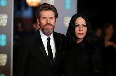 Willem Dafoe and wife Giada Colagrande arrive at the Bafta awards. Hannah McKay/Reuters