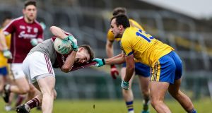 Galway's David Wynne comes under pressure from  Roscommo's Donie Smyth at Hyde Park. Photograph: Laszlo Geczo/Inpho