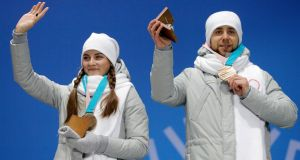 "Aleksandr Krushelnitckii with his wife Anastasia Bryzgalova during the medal ceremony for the curling mixed doubles event at the Olympics.  ""They'll be divorced by March."" Photograph: Antonio Bat/EPA"