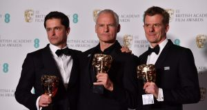 Producer Peter Czernin, British-Irish filmmaker Martin McDonagh  and British producer Graham Broadbent (right) pose with their awards for Outstanding British Film for the film  at the Baftas at the Royal Albert Hall in London. Photograph: Ben Stansall/AFP/Getty Images