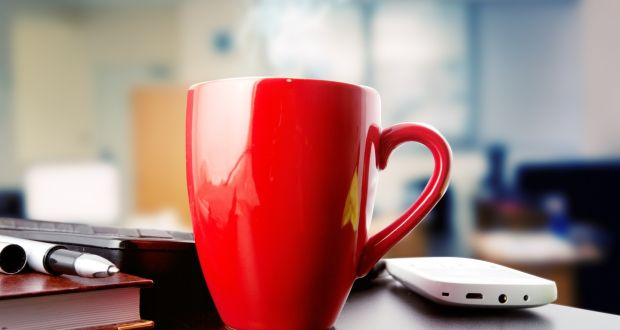 Personal mugs  offer a measure of personal control and identity in largely anonymous open plan offices. Photograph: iStock