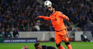 Mohamed Salah of Liverpool rounds Porto's Jose Sa to score in their Champions League clash. Photo: Julian Finney/Getty Images