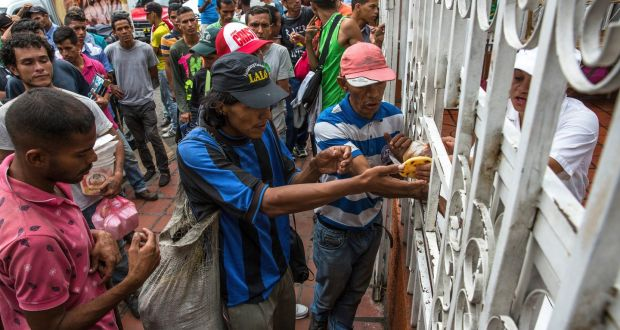 In Colombia border town, desperate Venezuelans sell hair to