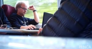 A still taken from surveillance footage of Matthew Falder on a train. Photograph:    National Crime Agency/PA Wire