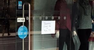 "A sign on a Dublin city-centre shop on Monday reads: ""Temporarily closed due to power cut."" Photograph: Dominic Coyle"