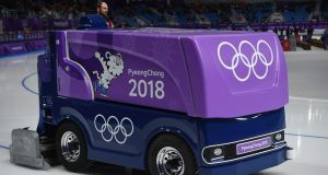 An ice technician  drives a Zamboni before the men's 1,500m speed skating event at the Pyeongchang 2018 Winter Olympic Games. Jung Yeon-Je/AFP/Getty Images