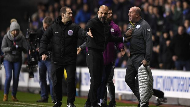 Manchester City manager Pep Guardiola argues with Wigan Athletic manager Paul Cook during the FA Cup fifth-round match at DW Stadium Photograph: Gareth Copley/Getty Images