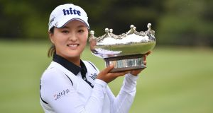 Jin Young Ko from Korea celebrates with her trophy after winning the Australian Women's Open golf tournament at the Kooyonga Golf Club, in Adelaide. Photo: David Mariuz/EPA