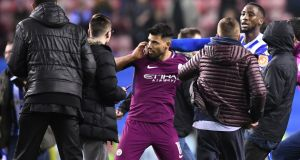 Sergio Aguero is surrounded by fans as he attempts to leave the pitch after the Emirates FA Cup fifth round match between Wigan Athletic and Manchester City at DW Stadium. Photo: Gareth Copley/Getty Images