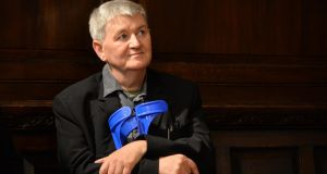Philip Casey listening to poetry readings at his 65th birthday at the Mansion House. Photograph: Sara Freund