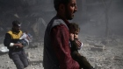 Children rescued from destroyed buildings in Syria's rebel-held Ghouta