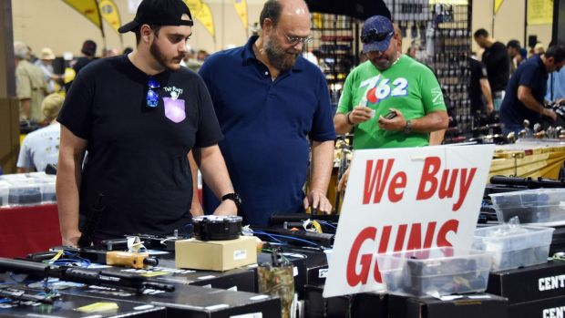 Gun enthusiasts at the South Florida Gun Show in Miami, Florida, on February 17th. Photograph: Michele Eve Sandberg/AFP/Getty Images