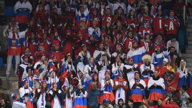 Russian fans attend the figure skating at the Gangneung Ice Arena. Photo: Roberto Schmidt/Getty Images