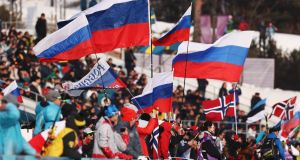 Fans wave Russian flags during Cross-Country Skiing men's 4x10km relay on day nine of the PyeongChang 2018 Winter Olympic Games at Alpensia Cross-Country Centre. Photo: Lars Baron/Getty Images