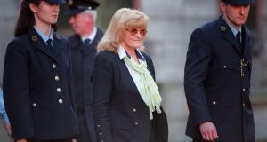 Catherine Nevin being lead away after her conviction for murder in 2000. Photograph: Dara Mac Dónaill