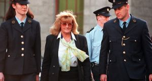 Catherine Nevin being escorted by prison officers and gardaí follwing a legal challenge she took at the High Court in 2000. Photograph: Eric Luke