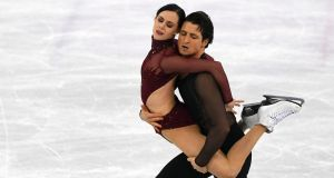 Tessa Virtue and Scott Moir of Canada compete during the free dance portion of the ice dance event as they claimed the golf medal. Photograph: James Hill/New York Times