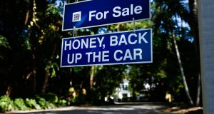 A For Sale  sign  outside  a home in Miami, Florida. Photograph:  Getty Images