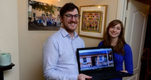 Michael Doyle and Rosanna Kleemann with their laptop which they  used to find their new home. Photograph: Cyril Byrne