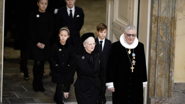 Danish Queen Margrethe (L) is led into the church by royal confessor Erik Norman Svendsen. Photograph: Mads Claus Rasmussen DENMARK OUT/AFP