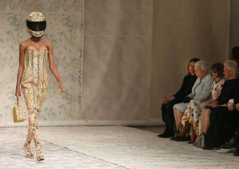 ROYAL STYLE: Queen Elizabeth II attends the Richard Quinn show at London Fashion Week.  Photograph: Paul Hackett/Reuters