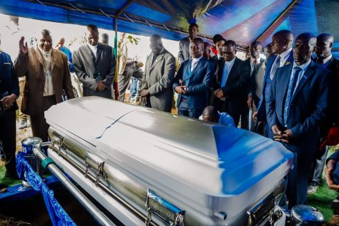PAYING RESPECTS: Members of Zimbabwe's Movement for Democratic Change political party pay their respects around the coffin of late opposition leader Morgan Tsvangirai, who died last week after a battle with cancer, during his funeral at his rural village of Humanikwa. Photograph: Jekesai Njikizana/AFP/Getty Images