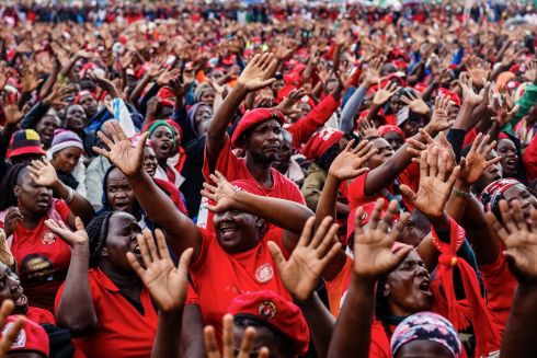 WAVING GOODBYE: Mourners and supporters of the Movement for Democratic Change  wave goodbye to late Zimbabwean opposition leader Morgan Tsvangirai during his funeral at his rural village of Humanikwa. Photograph: Jekesai Njikizana/AFP/Getty Images