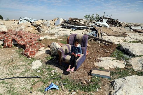 ANCIENT CONFLICT: A Palestinian girl sits on a couch after Israeli troops destroyed a Palestinian property in the village of Al-Eizariya, in the occupied West Bank, east of Jerusalem. Photograph: Ammar Awad/Reuters
