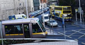 Longer and more frequent Luas trams will travel through College Green by the end of March, requiring priority access to meet journey-time targets. File photograph: Cyril Byrne