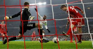 Thomas Müller opens the scoring for Bayern Munich in the Champions League round of 16 first leg against Besiktas at the Allianz Arena. Photograph: Michaela Rehle/Reuters