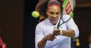 Serena Williams of the US in doubles action with her sister Venus in the Fed Cup. Photograph: PA