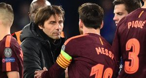Lionel Messi shakes hands with Antonio Conte after the the match at Stamford Bridge. Photograph: Getty Images