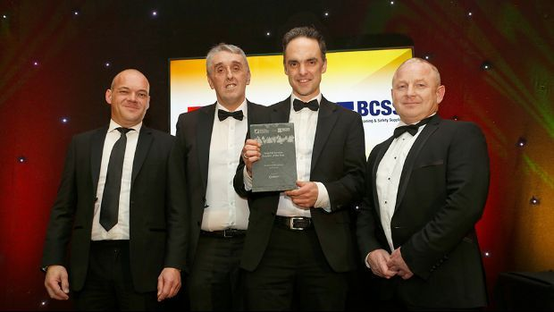 Roger O'Shea, Commercial and Operations Manager, Electro presents the Total FM Service Provider of the Year award to Stuart McIntosh, Paul Guy and Roger Brennan Aramark Workplace Solutions